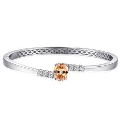 Zilveren bangle armband met champagnekleurige zirkonia